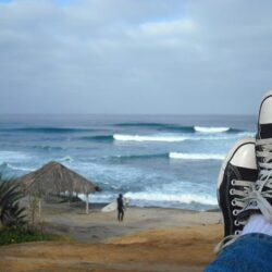 Brass Ring Multimedia - image of Chuck Taylor All-Star black low-tops, Windansea Beach, La Jolla, CA.